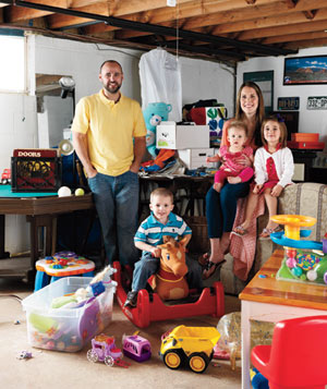 Michael, Nancy, Olivia, Jake, and Autumn Palutis in their cluttered basement