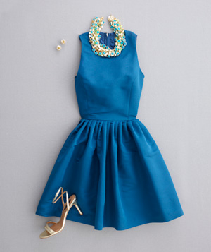 Cobalt blue dress with high neckline, large necklace and strappy heels