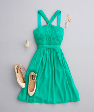 Green halter dress with gold flats and jewelry
