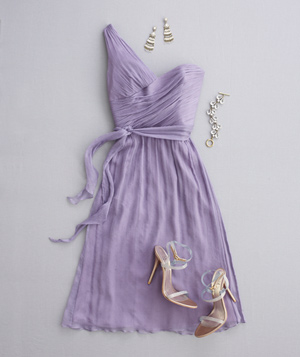Purple dress with one-shoulder neckline, strappy heels, and silver jewelry