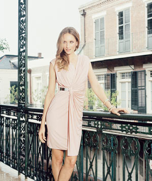 Model wearing light pink wrap dress