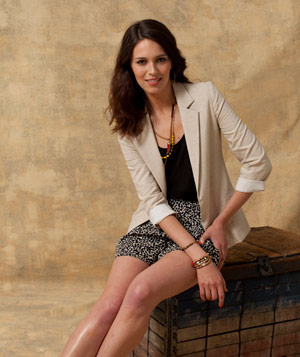 Model wearing animal print shorts and a tan blazer