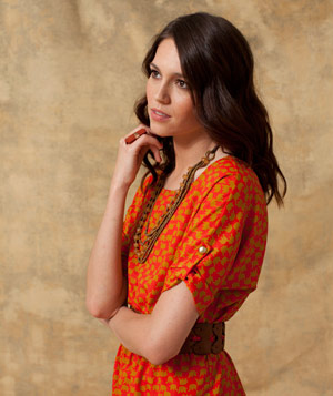 Model wearing orange elephant patterned dress