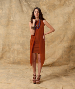 Model wearing layered orange dress