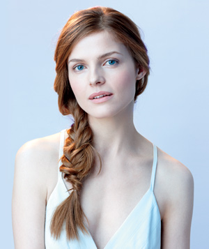 Model wearing a side fishtail braid hairstyle