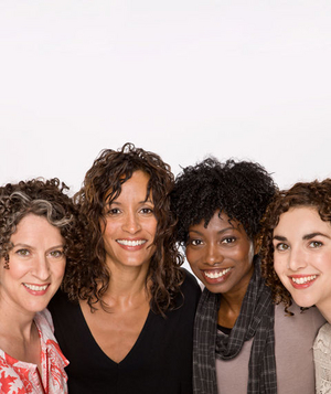 Four women with curly hair