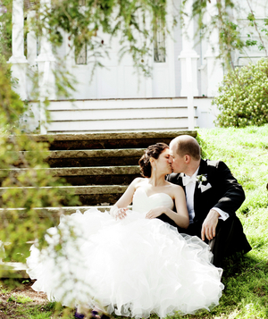 Married couple kissing on the steps