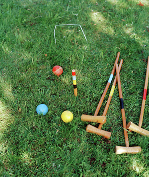 Croquet mallets and balls in the grass
