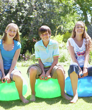 Teenagers sitting on bouncy balls
