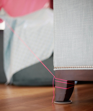 Chair leg holding pink string