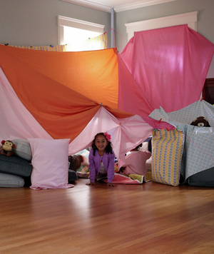 Little Girl Inside Large Indoor Fort
