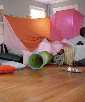 Big fort made of sheets and pillows
