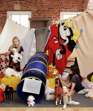 Blankets and towels hung on clothing lines to create a fort