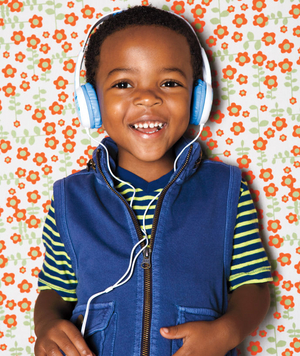 Little boy in a vest wearing headphones