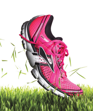 Pink running shoe on grass