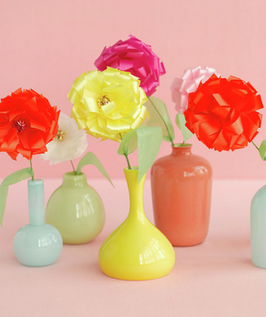 Bow flowers in colorful vases