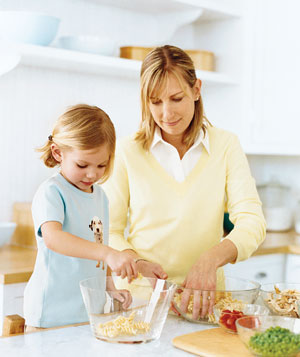 Mother and daughter making a pasta salad