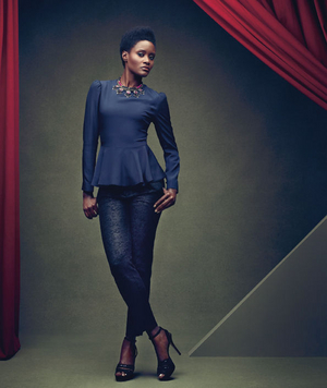 Model wearing a peplum top and skinny pants
