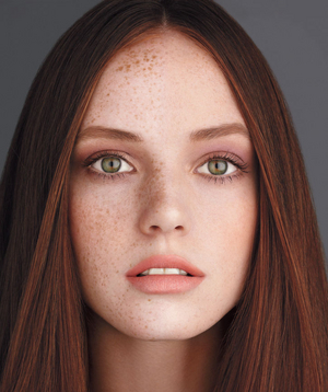 Model wearing cover-up on one half of her face