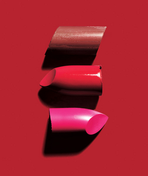 The tops of three lipsticks