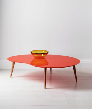 Orange kidney table and large gold bowl