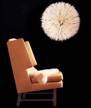 Elephant chair, sheepskin rug, and feather headdress