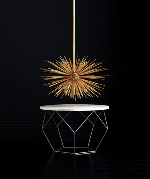 Gold chandelier and origami coffee table