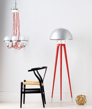 A chandelier, a chair, a lamp, and a bronze sculpture
