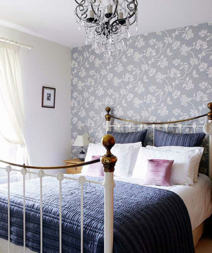 Floral wallpapered bedroom