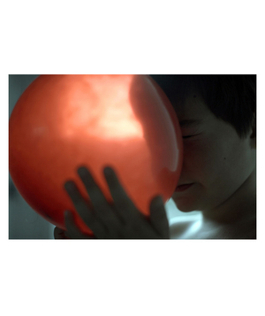 Red Balloon: Elijah Archibald holding a balloon