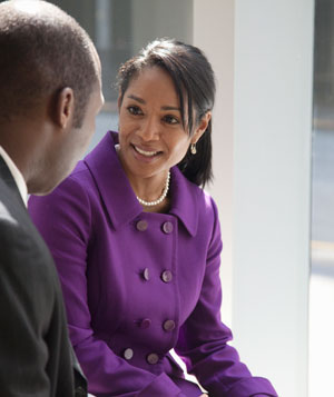 Business woman listening to colleague intentedly