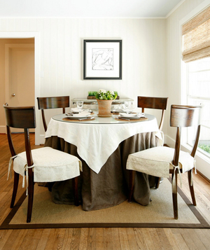 Linen and glass covered dining room table