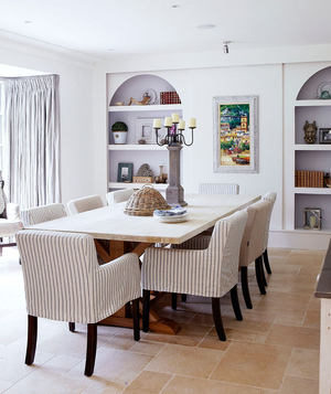 Large dining room with striped slip covers