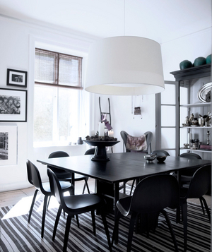 White dining room with black decor