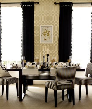 Zebra Striped Chairs And Fringed Curtains In A Dining Room