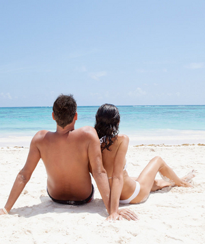 Couple lounging on the beach