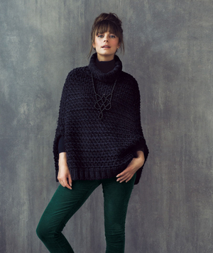 Model wearing Mango cape and evergreen-colored corduroys