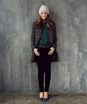 Model wearing knit hat and tweed topcoat