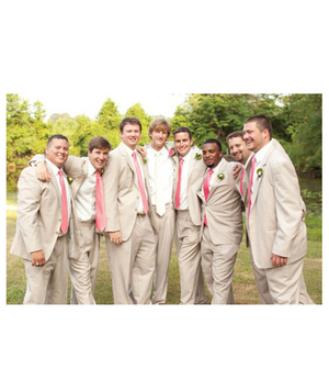 Groomsmen wearing khaki suits and pink ties