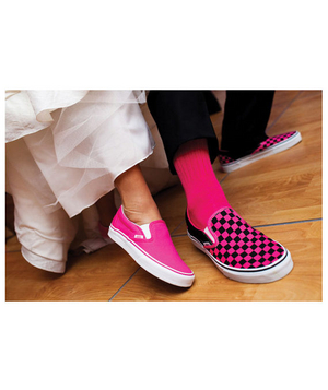 Bride and groom wearing hot pink sneakers