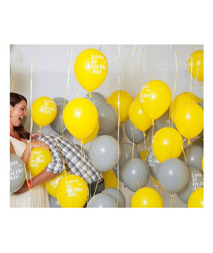 A bride with gray and yellow balloons