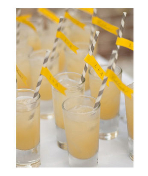 Signature cocktails with gray and yellow straws