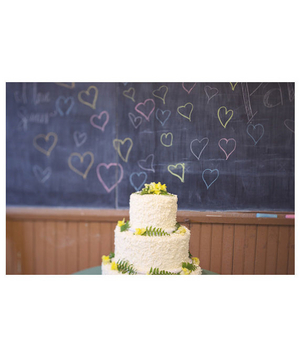 Wedding cake in front of a chalkboard