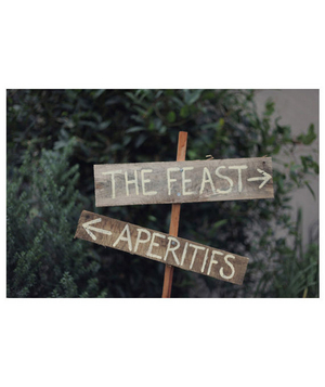 Wooden arrow signs at a wedding reception