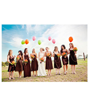 Bride and bridesmaids with colorful balloons and orange bouquets