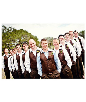 Groom and groomsmen wearing brown vests