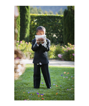 Young ringbearer wearing suit