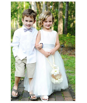 Ring bearer and flower girl wearing flip flops