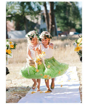 Two flower girls wearing green tutus