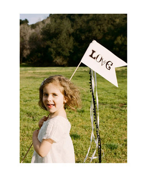 Little girl holding love sign